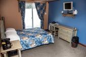 Motel du domaine - Lit double avec porte patio